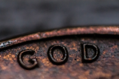 Finding God- Detail on a Lucky Penny, with Focus on God