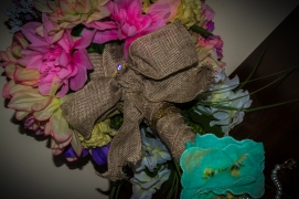 Bouquet Detail - Necklace wrapped and fastened around bouquet and bow for something old. Handkerchief and flowers for something blue. (137)